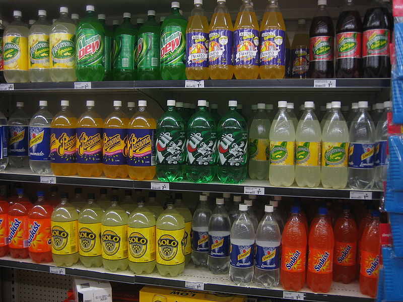 soda soft drink 2 liter bottles on shelf at supermarket